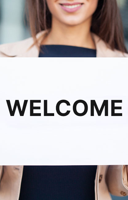 girl holding welcome banner
